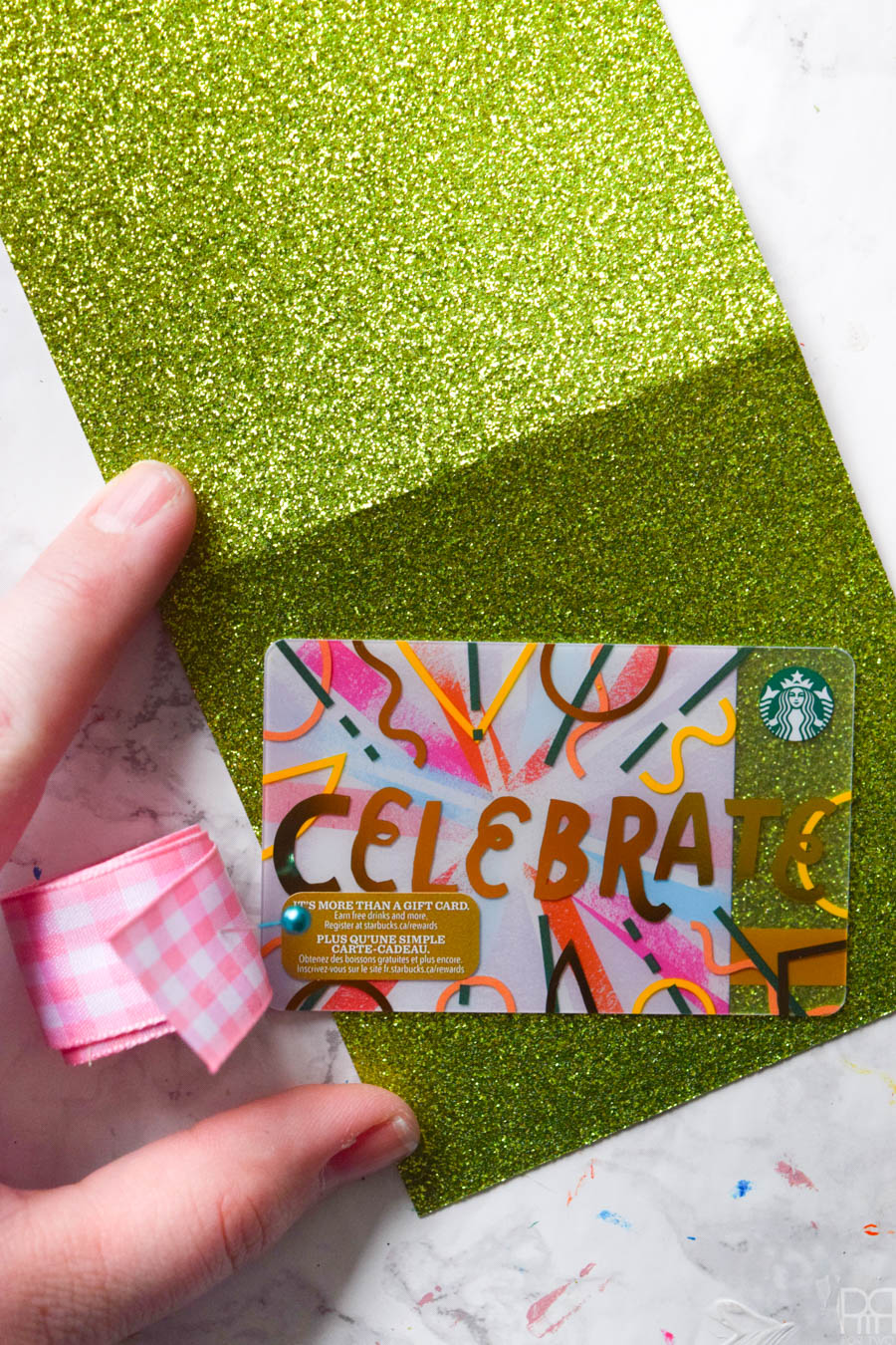 Create your own unique DIY Gift Card Holders using craft supplies and ribbon. They're colourful, fun, and best of all - no one will know if you left their gift until the last minute! #giftcardholder #glittercardstock #giftcardholderdiy