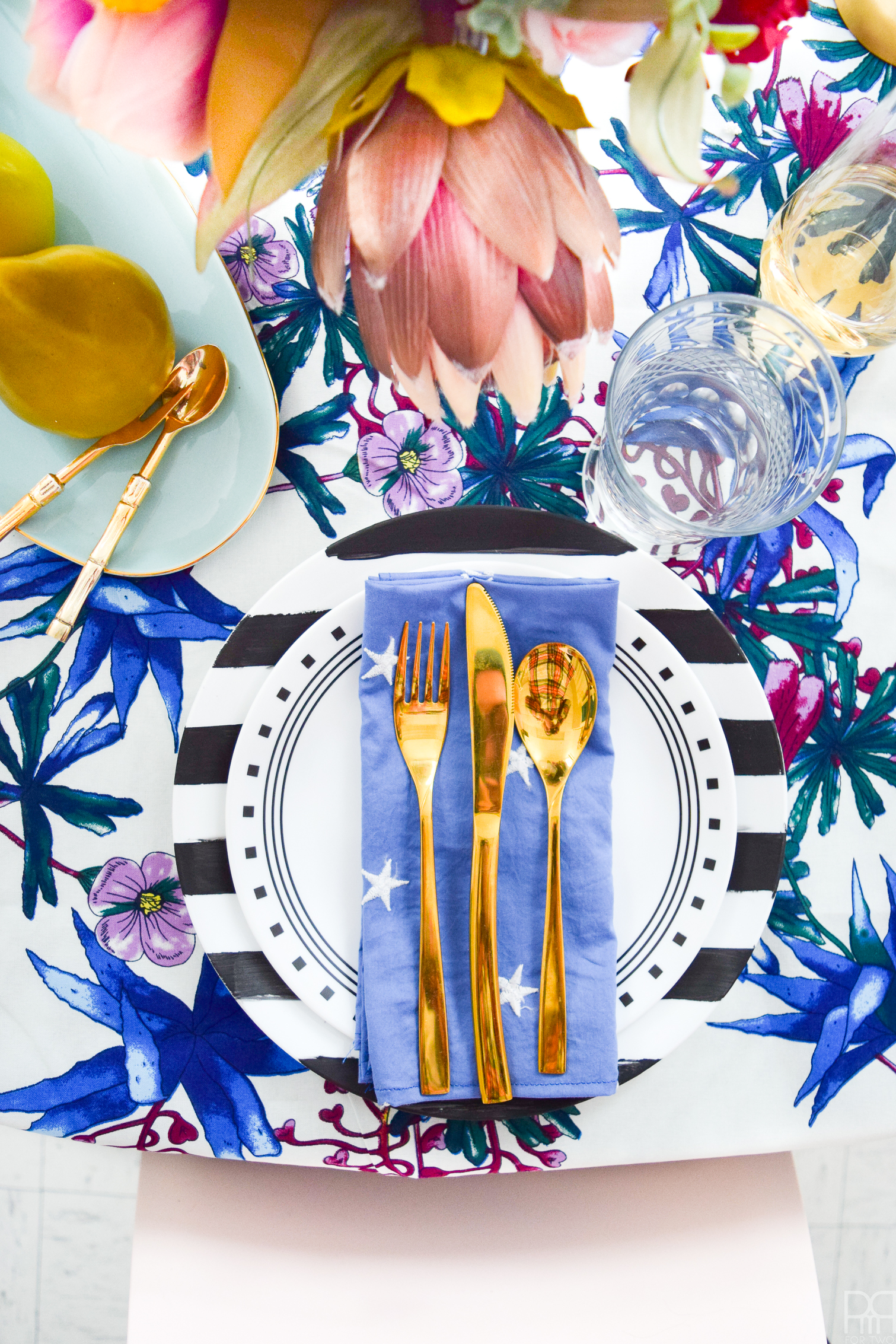 A Blue Valentine Romantic Tablescape for those of us who don't celebrate Valentine's day in a traditional way. Lush florals, rich purples and royal blues are what makes this place setting unique.