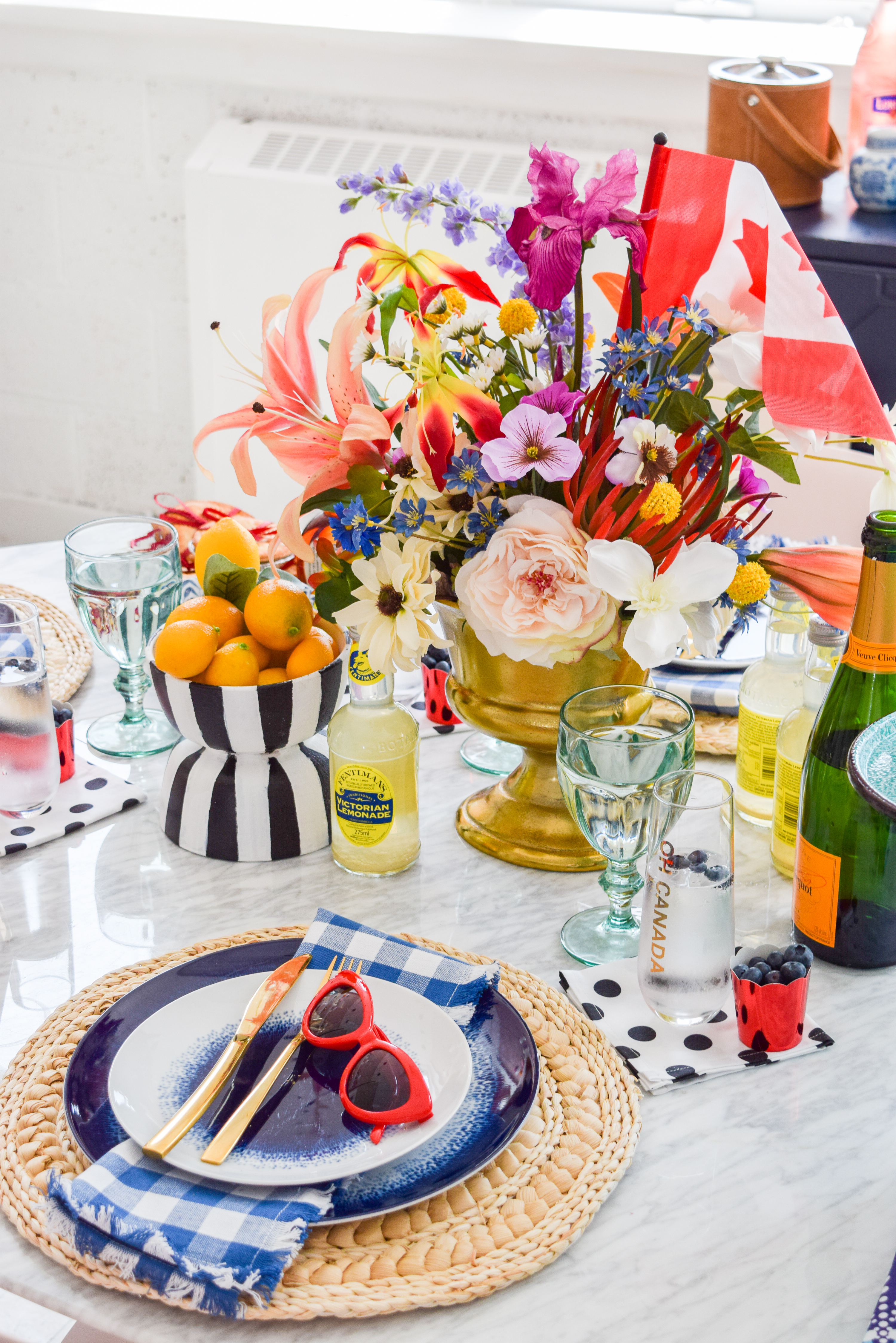 A patriotic Canada Day Blue & Floral Tablescape, that bristles with personality. Bold colours, great patterns, and traditional touches make it personal. I capped it off with Homesense finds, and Roostery linens. Grab some for yourself!