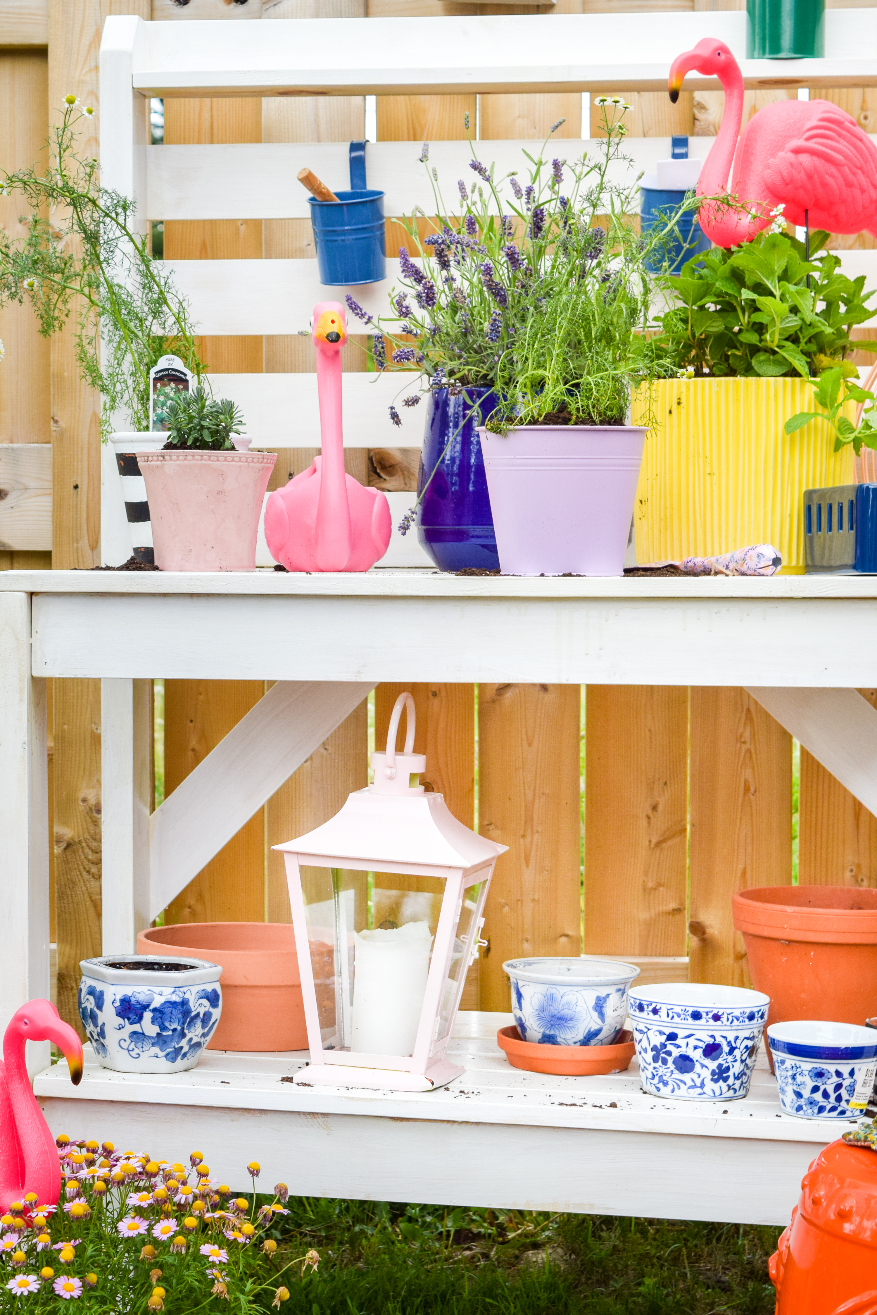 Looking for mosquito relief without all the candles and sprays? Try these mosquito repellent planters full of herbs and plants that keep them at bay. While you're at it, give your potting bench an update with a stylish white wash and a proper top coat to see it through the weather.