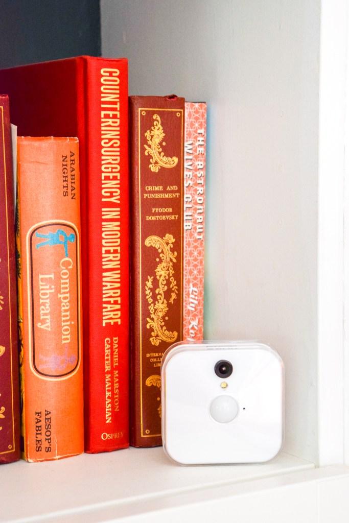 orange books and white security camera