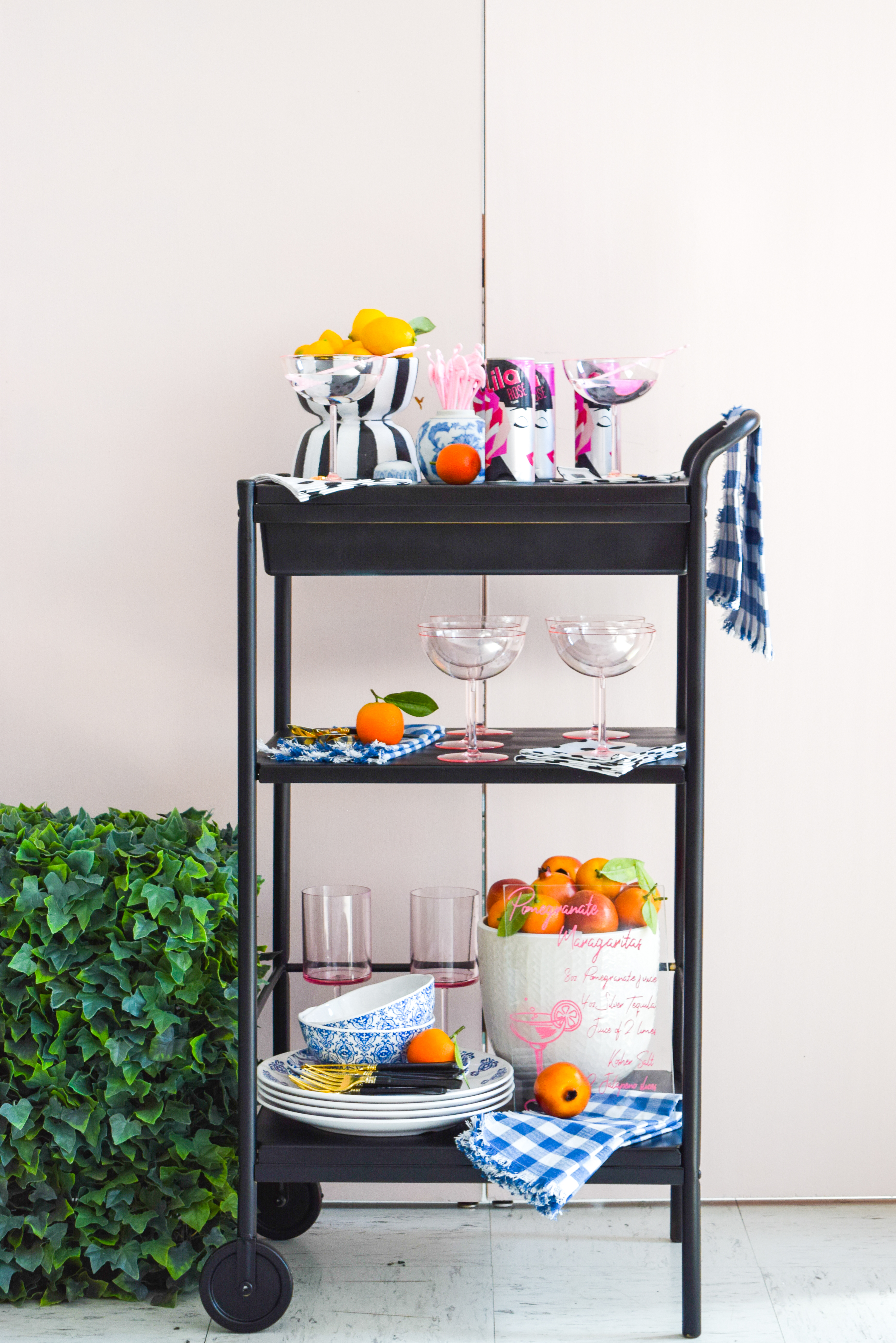 head on shot of black bar cart styled for summer