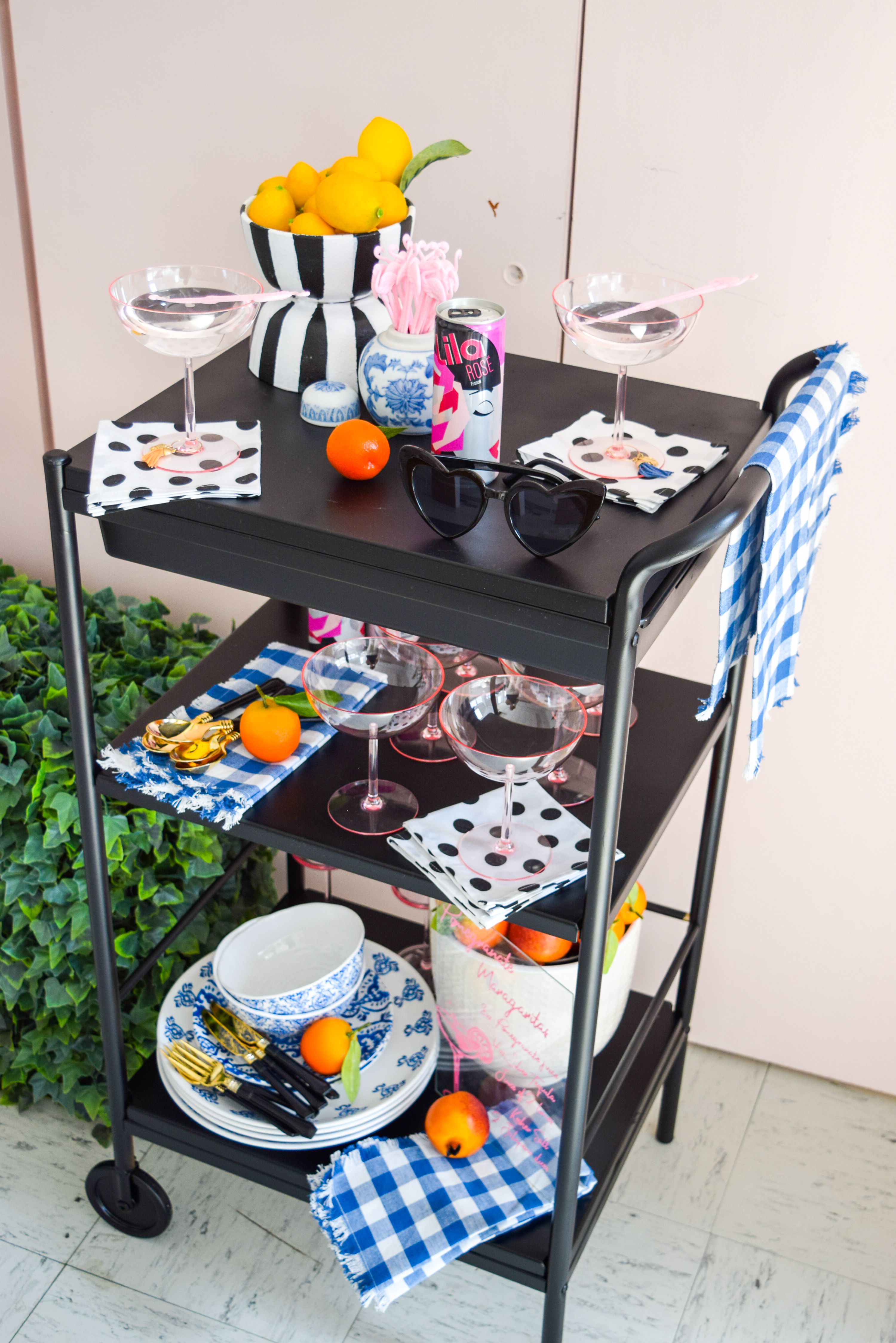 close-up angled shot of black bar cart with summer styling