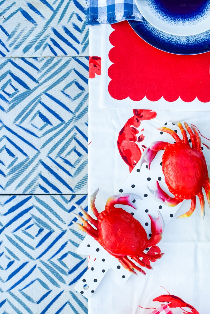 patterned floor tiles with crabs on table above