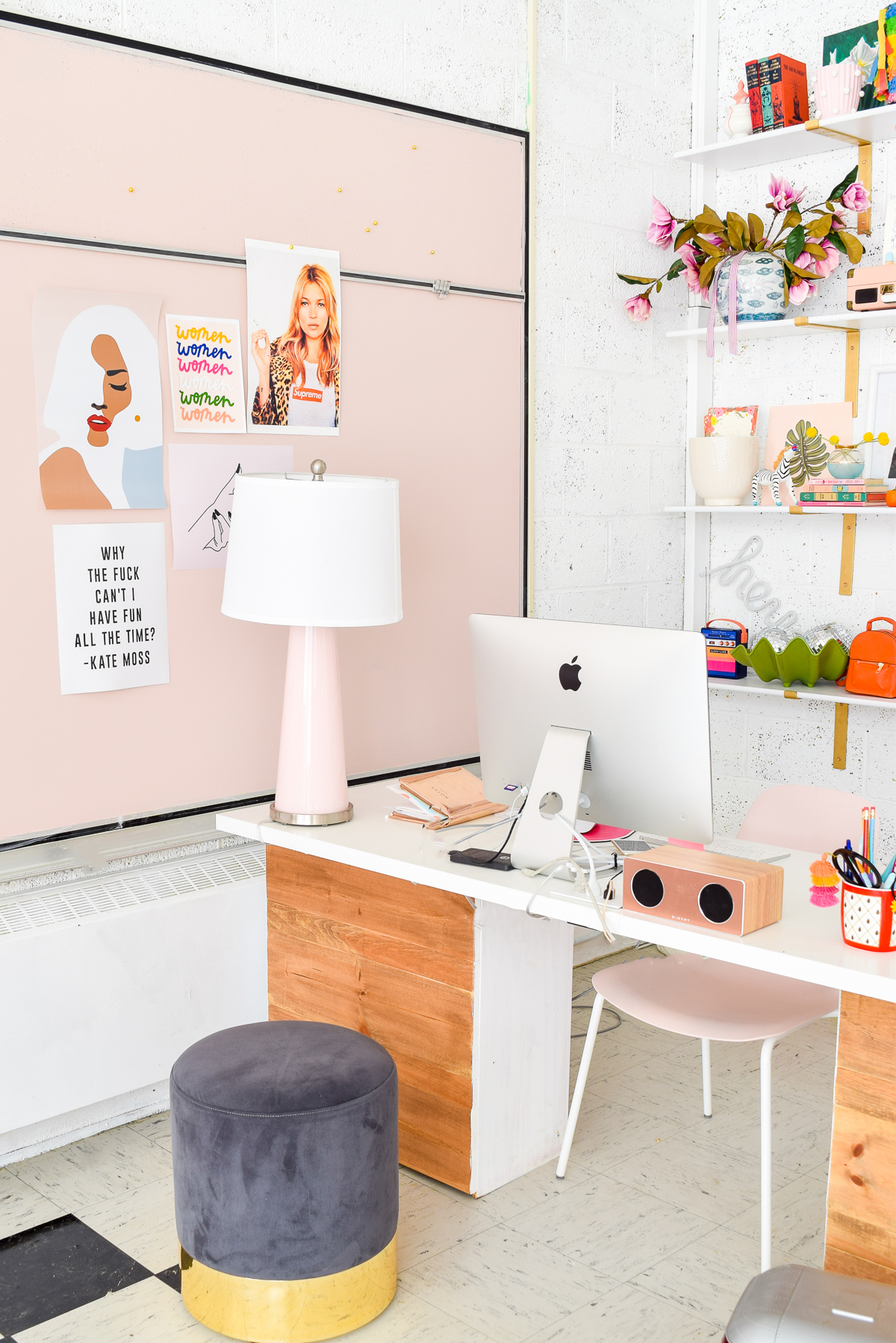 side shot of a desk next to a pink chalkboard