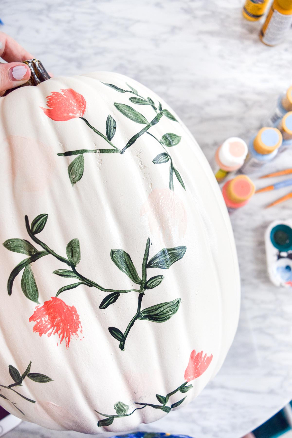process shot of a floral painted pumpkins