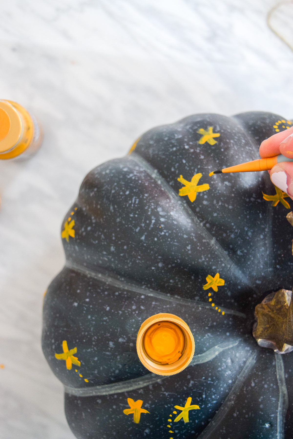 blue pumpkin with painted gold stars