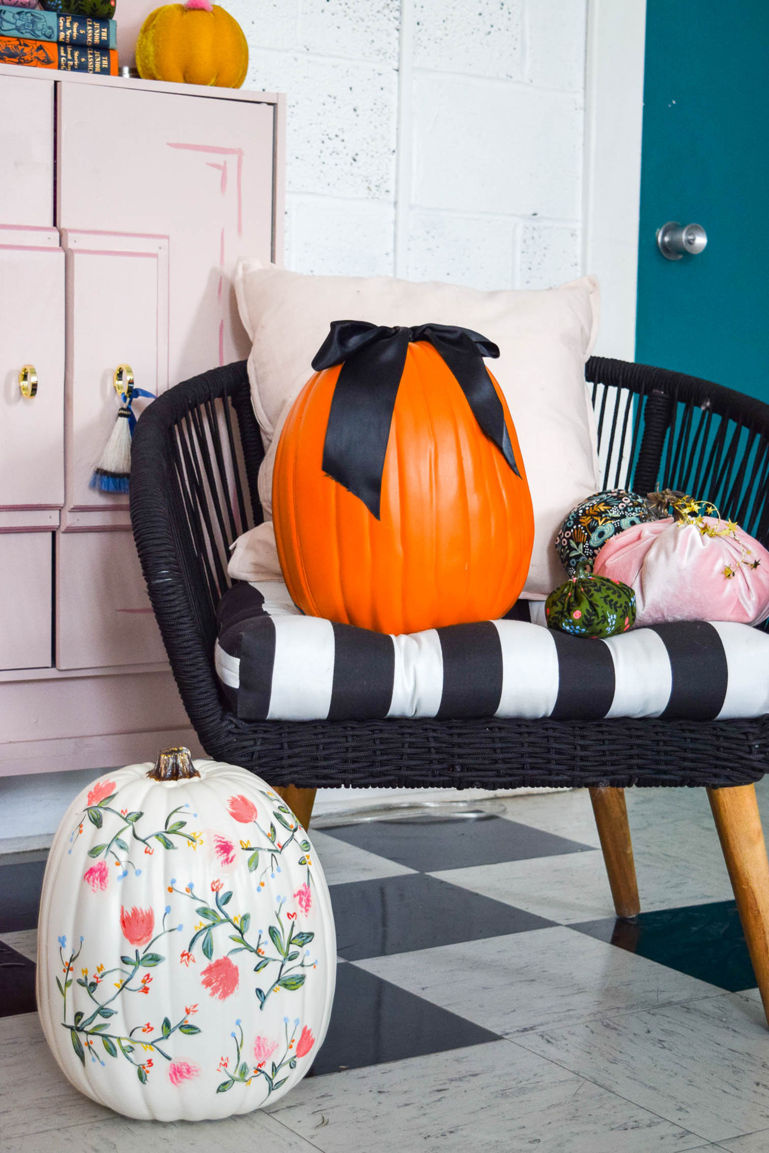pumpkins on a chair by the door