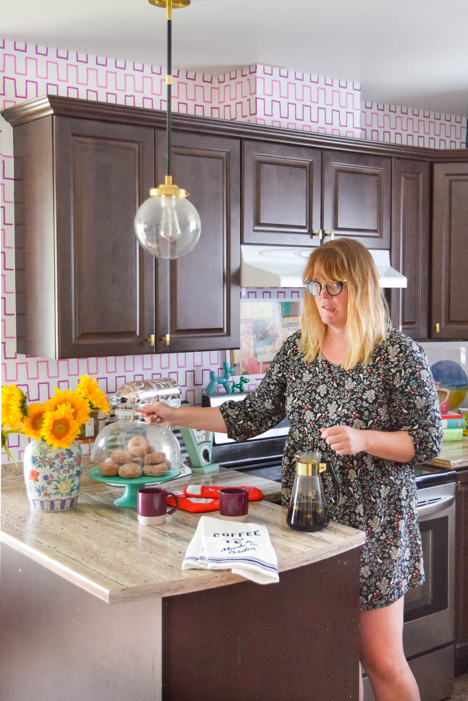 woman opening desert display in kitchen