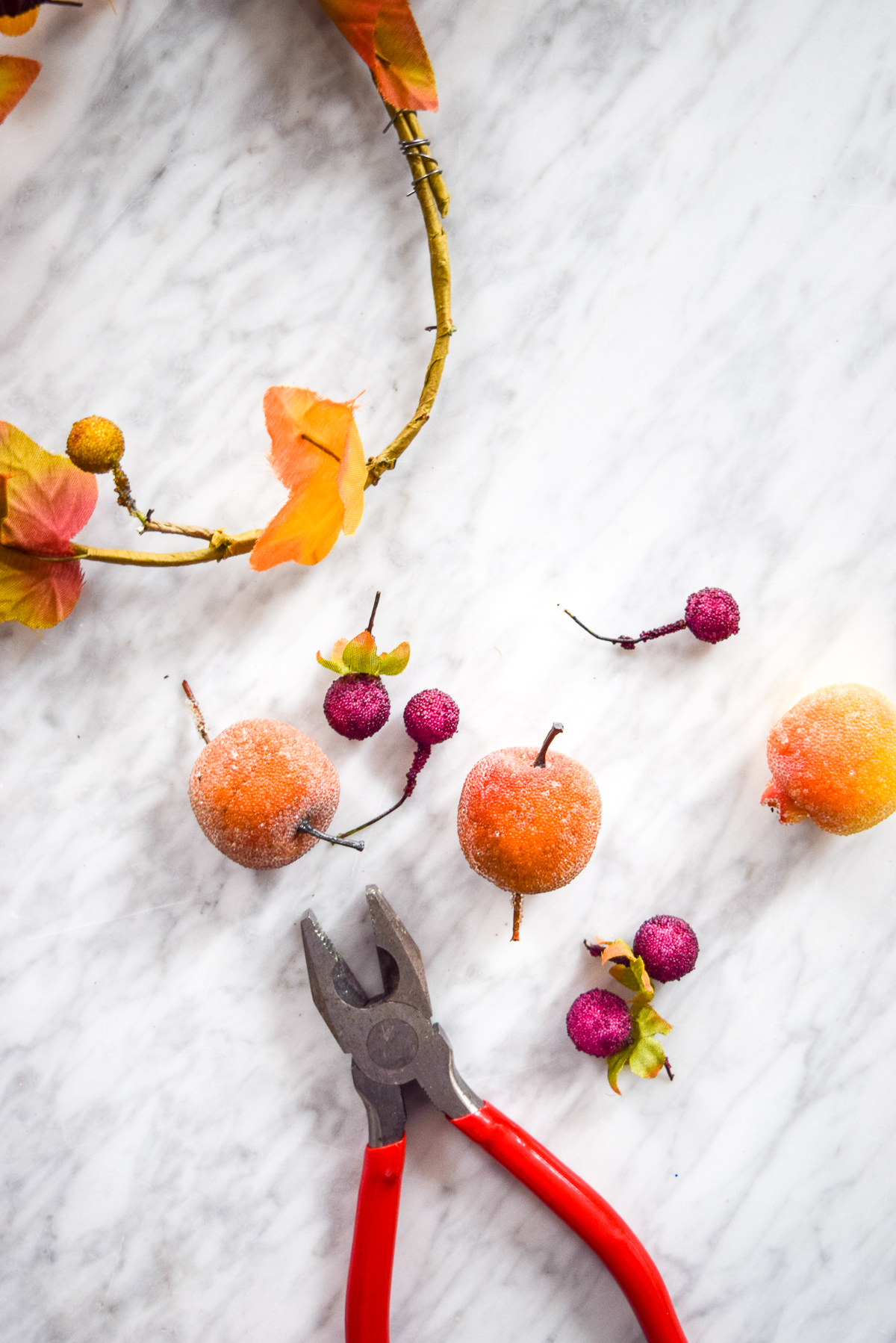 wire snippers on a marble table with fake fruit