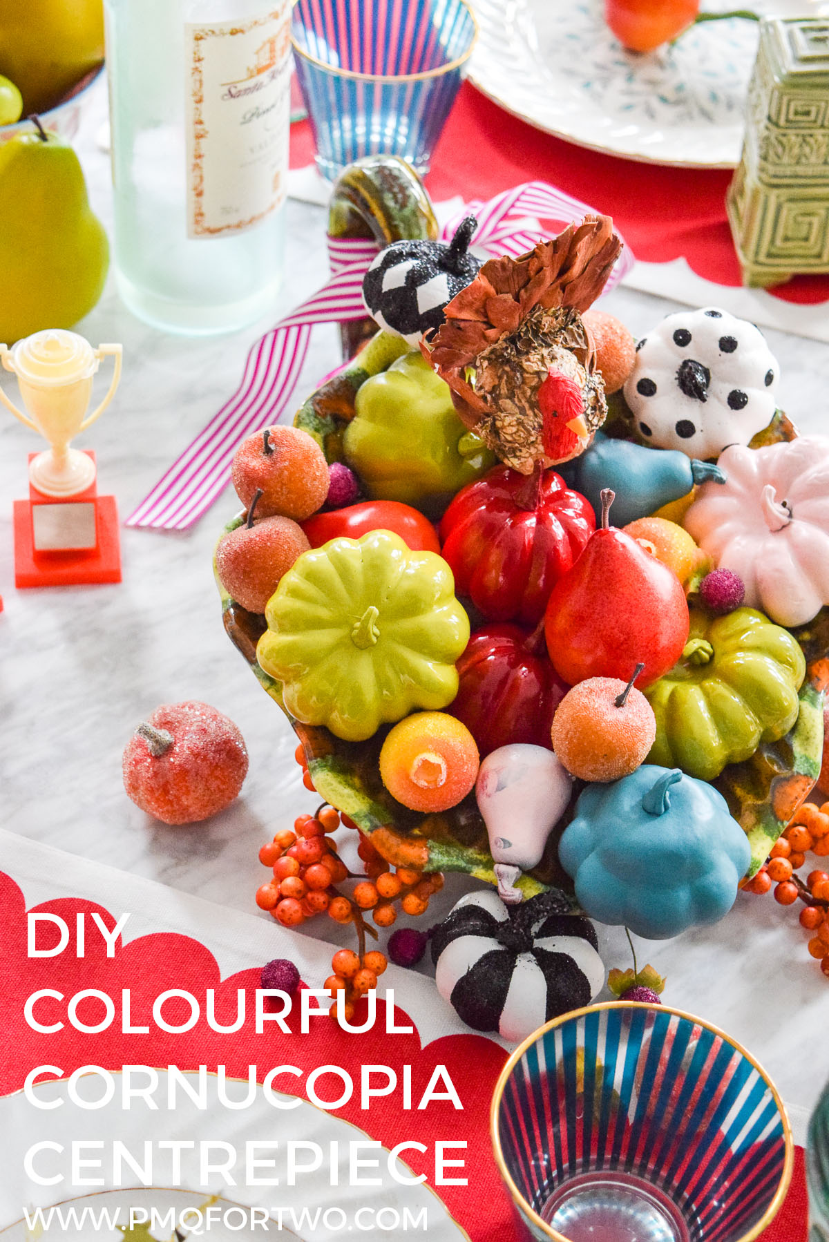 pinterest cover image of a colourful cornucopia at the center of a table