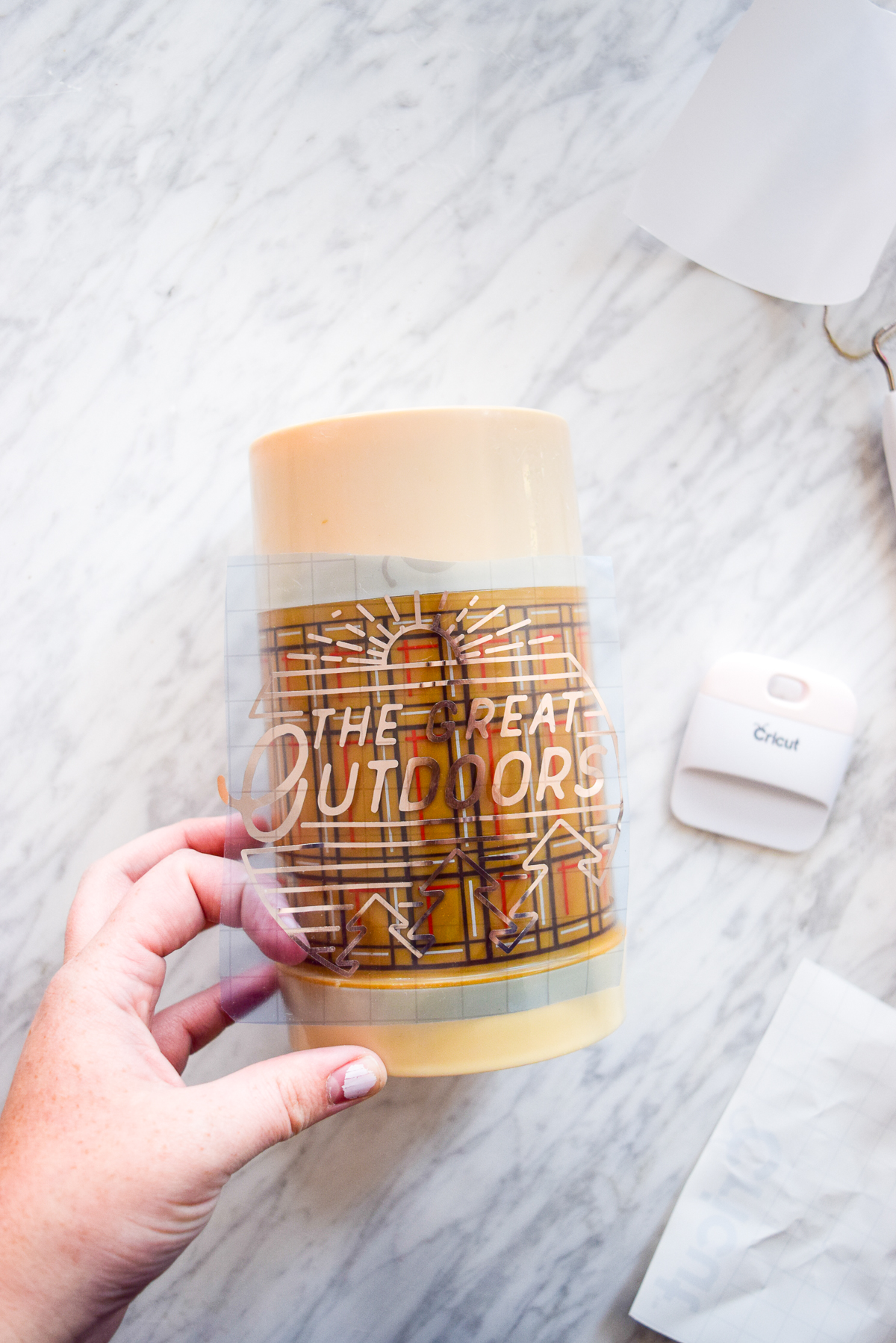 applying a vinyl decal using transfer tape to a thermos