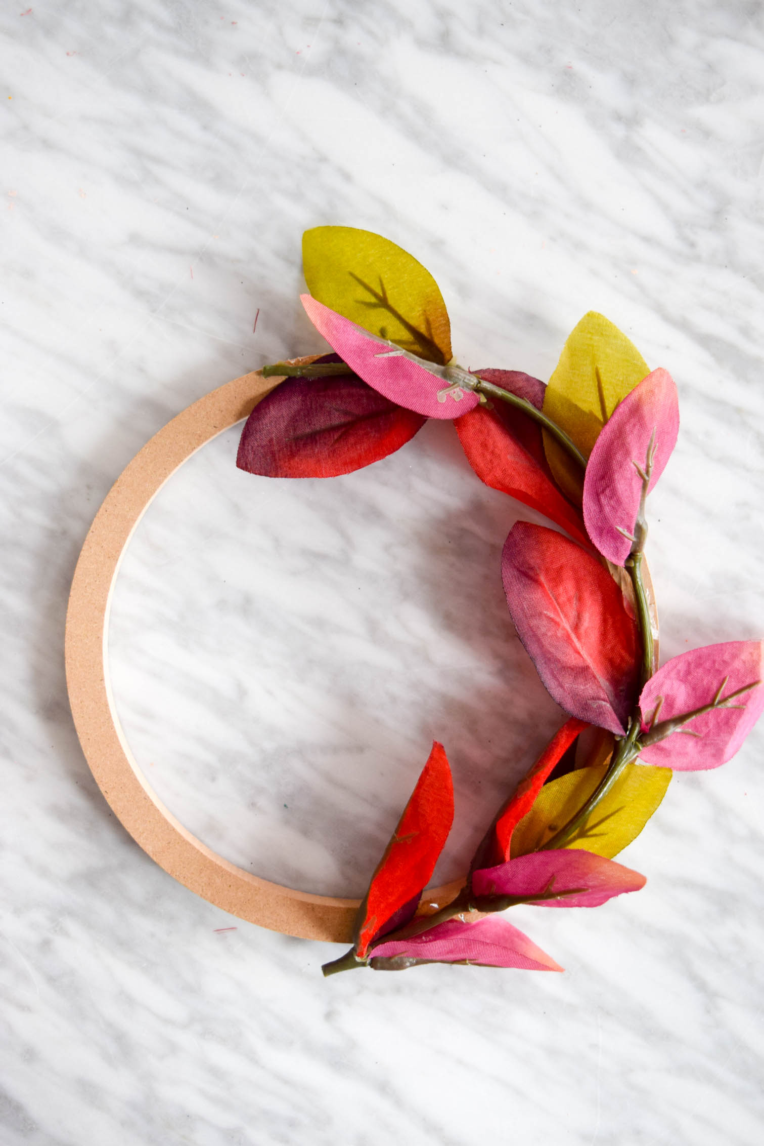 half assembled wreath on a marble table