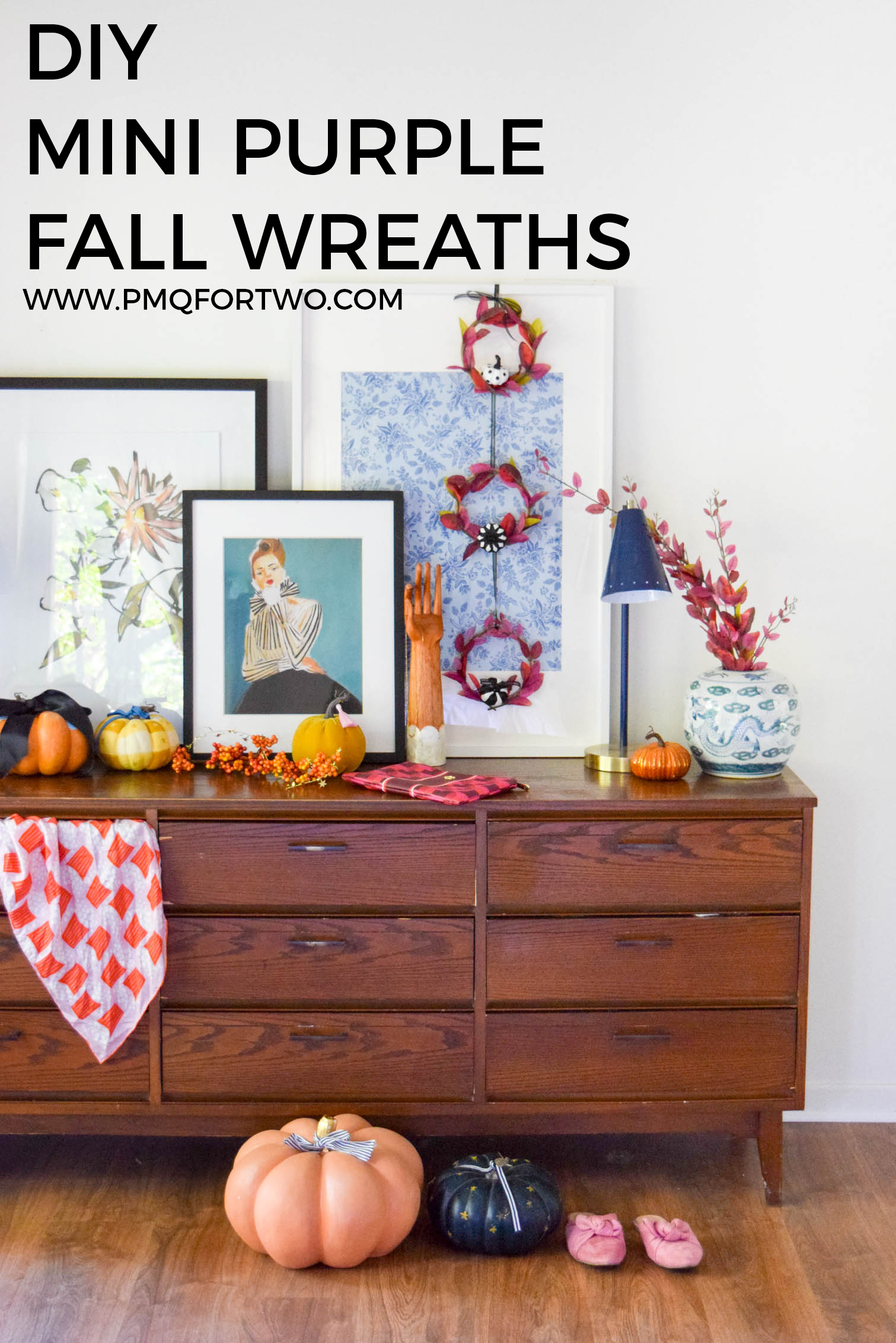mcm dresser decorated for fall with wreaths and pumpkins