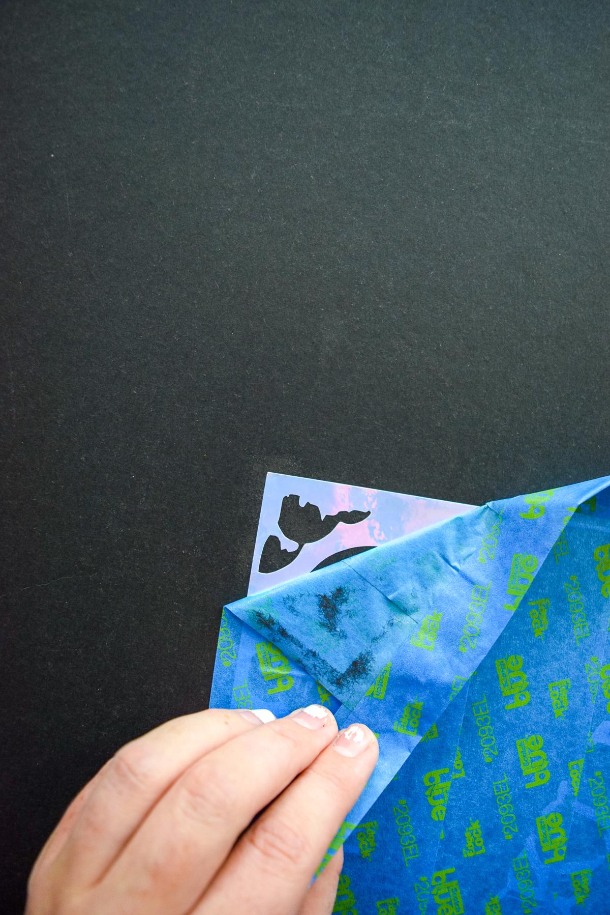 peeling back tape from a vinyl transfer