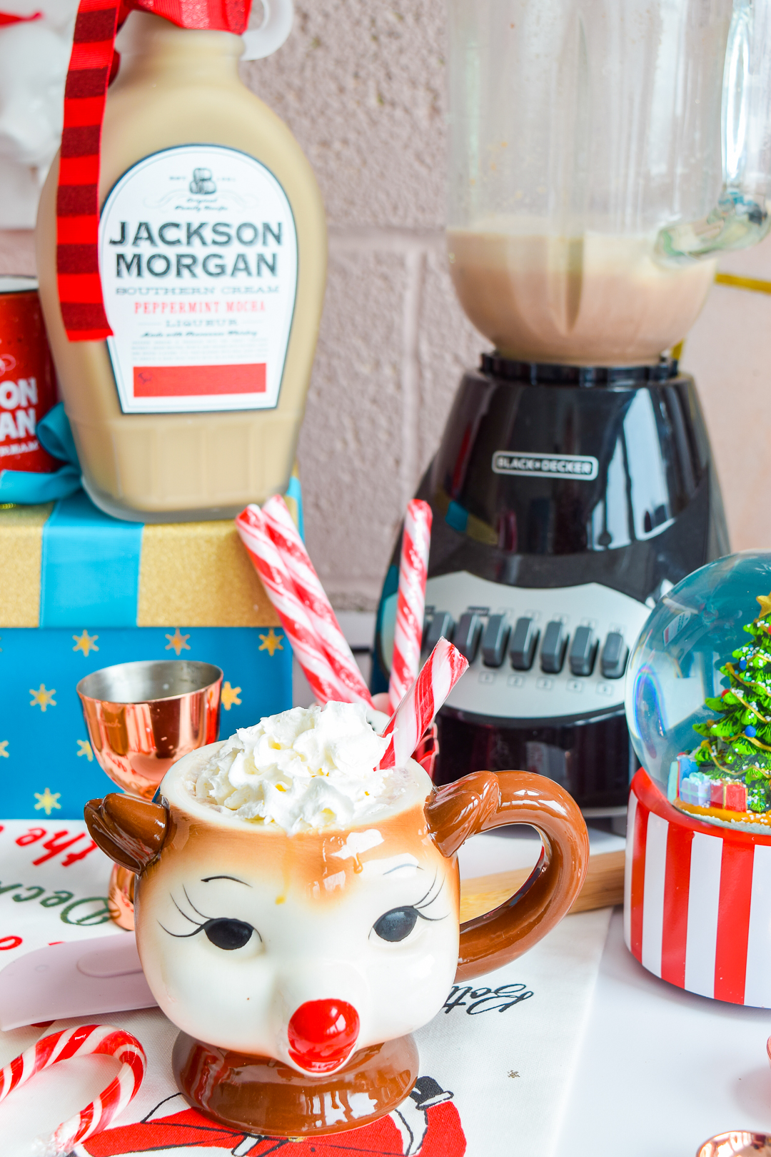 Girl, if you have not made a batch of these whiskey peppermint mocha frozen hot chocolates by the time you're done reading the post, you're doing it wrong. Jackson Morgan's Southern Cream is a tasty addition to any seasonal beverage, and it MAKES this one. #peppermintmocha #jacksonmorgan