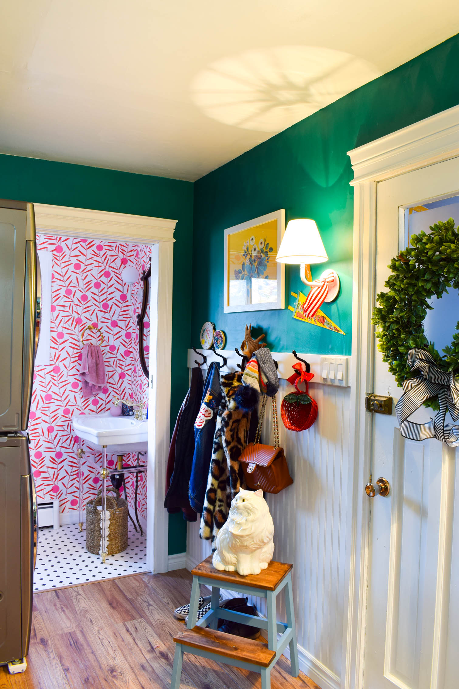 vintage laundry room decor is just what our space was missing! Colourful pennants and baskets, thrifted finds, and more! Come see how we added a retro touch.