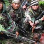 Indonesian soldiers pose with their West Papuan trophy kill.