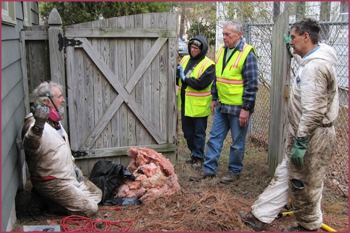 Steve Meacham, Eva Kuusinen-Coriveau, Jim Truitt, Rick Larson are at a site mucking out the bottom of a home.