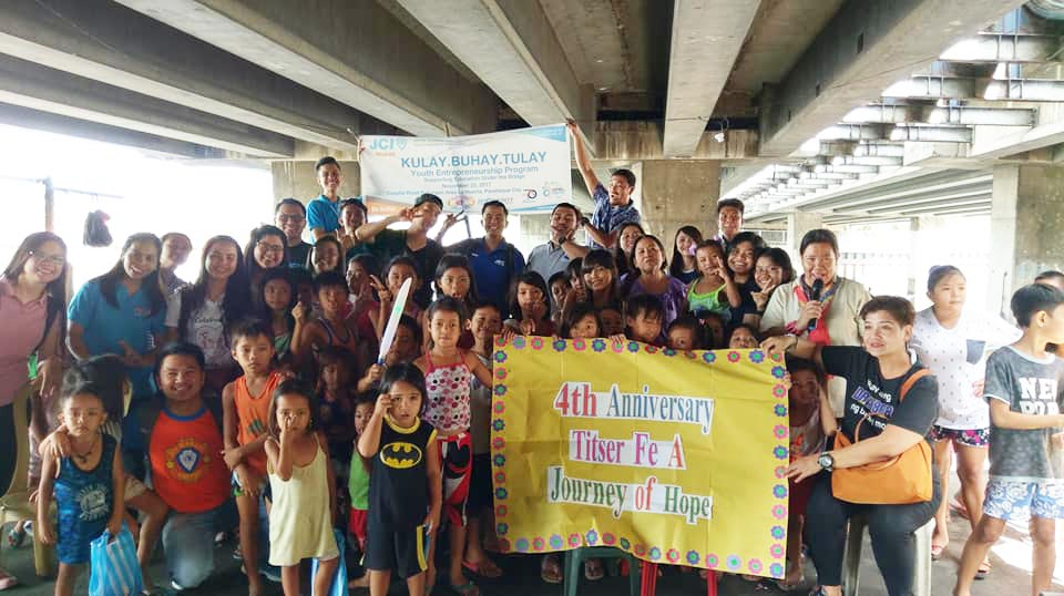 JCI Makati and Volunteers with Teacher Fe and Education Under the Bridge Beneficiaries
