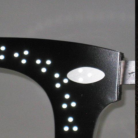 détails de l'enseigne triled derby pour opticien