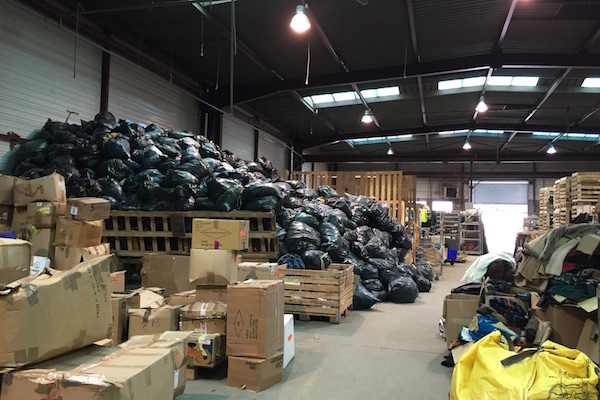 Pile of garbage bags filled with insulation material at Help Refugees L'Auberge des Migrants Warehouse