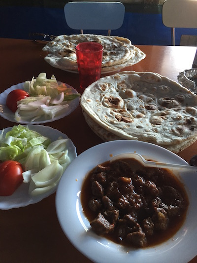 Beef korma, salad, and bread at the New Kabul Restaurant in the Calais Jungle