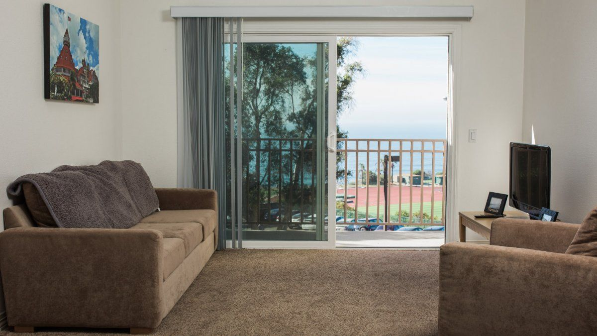 small resolution of a living room in the flex apartments complete with sofas and an ocean view