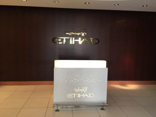 etihad first business class lounge premium abu dhabi auh chauffeur food champagne