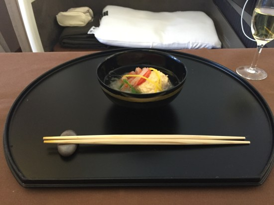japan airlines first class jal jl first class review flight champagne salon seat bed