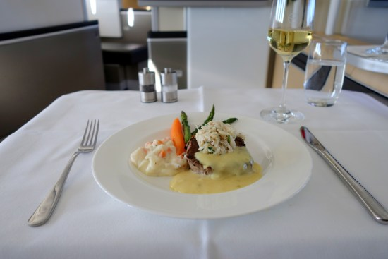 lufthansa first class lh ord fra champagne seat bed food business class steak crab meat