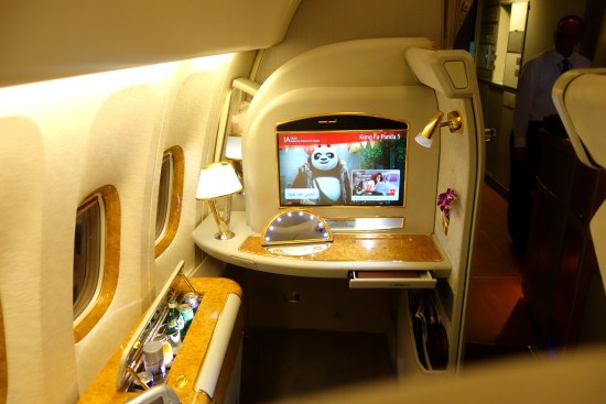 emirates first class 777 flight review seat champagne food suite flat seat food