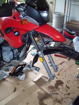 Sweet! the front wheel is off! That was easy. Now start taking the forks off. Loosten both the lower and upper clamps around the tubes and the forks will slide right out.
