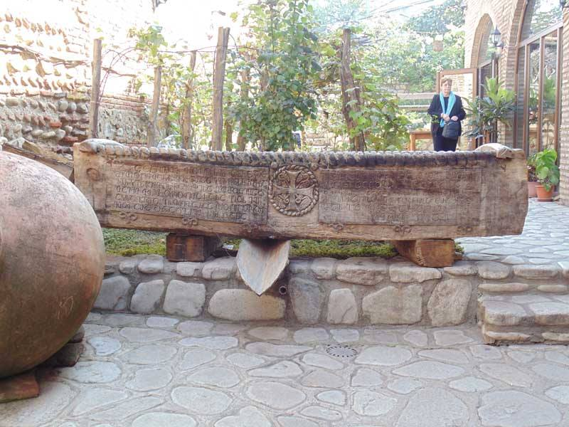 Ancient grape crusher at Pheasant's Tears Winery in  Signhnaghi