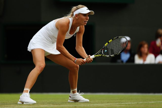 LONDON, ENGLAND - JUNE 25: Caroline Wozniacki of Denmark in action during her Ladies' Singles second round match against Naomi Broady of Great Britain on day three of the Wimbledon Lawn Tennis Championships at the All England Lawn Tennis and Croquet Club at Wimbledon on June 25, 2014 in London, England. (Photo by Matthew Stockman/Getty Images)