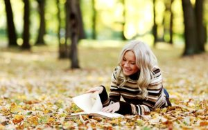 Blonde-Girl-Reading-Book-On-Yellow-Leaves-HD-Wallpaper