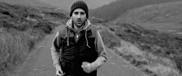 A  black and white image of lead singer Tigrane Minassian from Classroom Battles running down a road on a deserted moor taken from the video for the single Crosseyed horse.