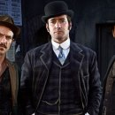A publicity image for the BBC drama Ripper Street. The image depicts the three male leads stood side by side in Victorian dress in a dark alley of Whitechapel.