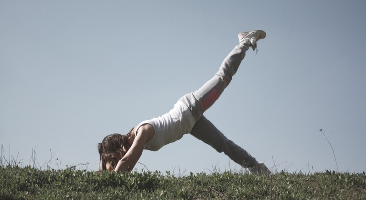 Woman stretching out in nature