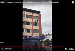 Bombeiros resgatam homem que tentava pular de prédio – VEJA VÍDEO