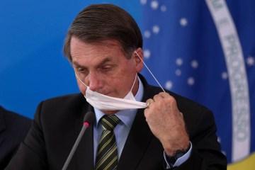 """b 2 - COVID-19: Bolsonaro aponta isolamento social como causa de """"outras mortes"""""""
