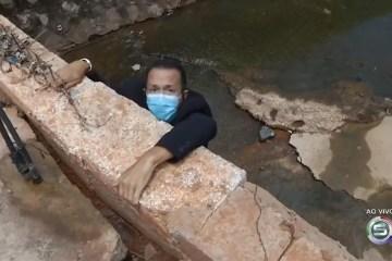 repórter pendurado - Jornalista se pendura em penhasco durante entrada ao vivo, cai e precisa passar por cirurgia