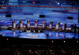 Republican presidential candidates are pictured during the Iowa GOP/Fox News Debate at the CY Stephens Auditorium in Ames, Iowa, Thursday, Aug. 11, 2011. Pictured left to right: former Pennsylvania Sen. Rick Santorum; businessman Herman Cain; Rep. Ron Paul, R-Texas, former Massachusetts Gov. Mitt Romney; Rep. Michele Bachmann, R-Minn.; former Minnesota Governor Tim Pawlenty; former Utah Gov. Jon Huntsman; former House Speaker Newt Gingrich. (AP Photo/Charlie Neibergall, Pool)