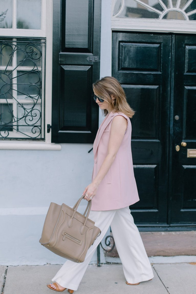 White Trousers and Pink Vest and Celine Handbag