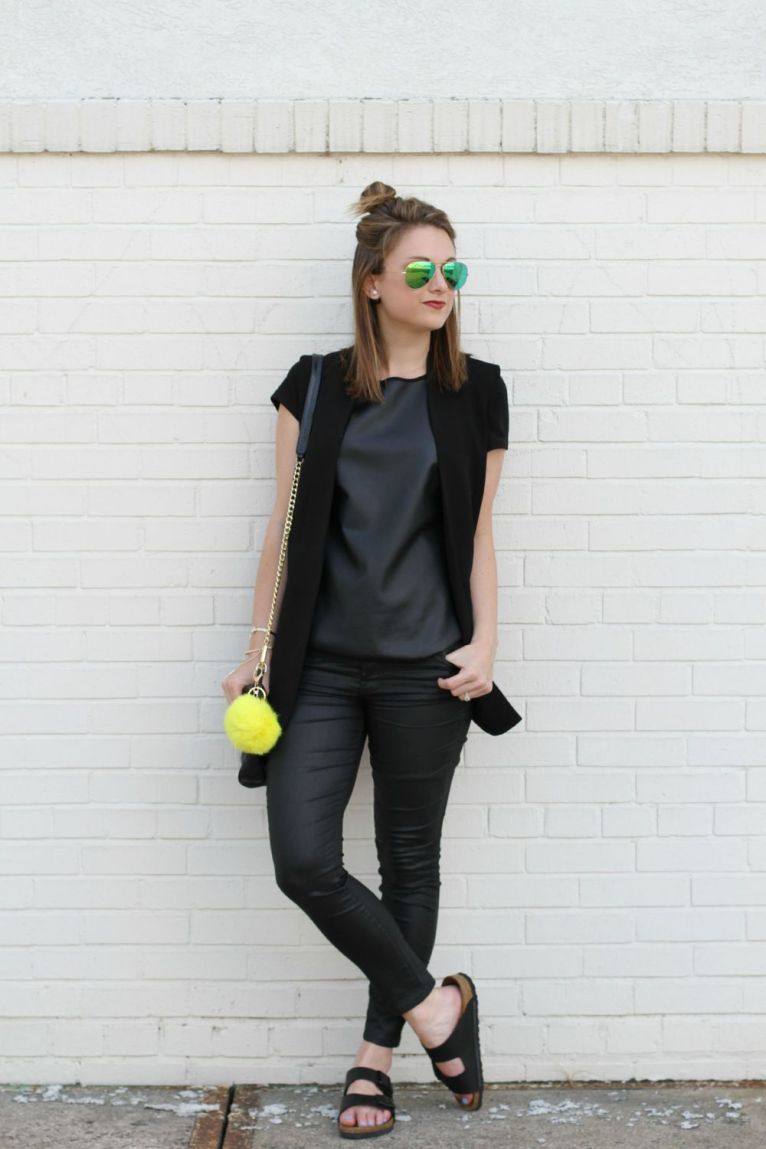 Black vest andblack leather tee shirt and black faux leather jeans