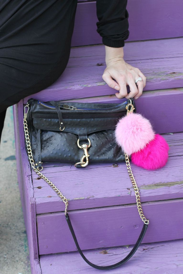 black cross body bag with poof charms