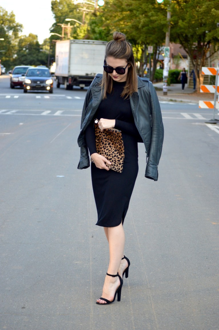 leather jacket and leopard clutch