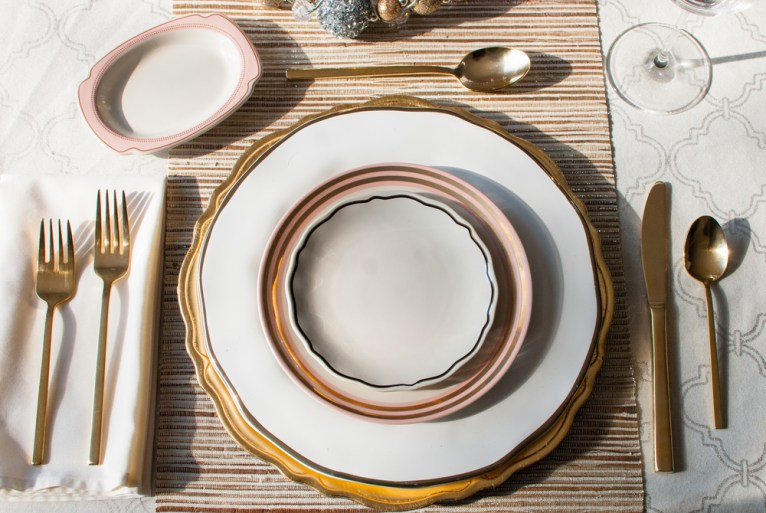 pink white and gold place setting