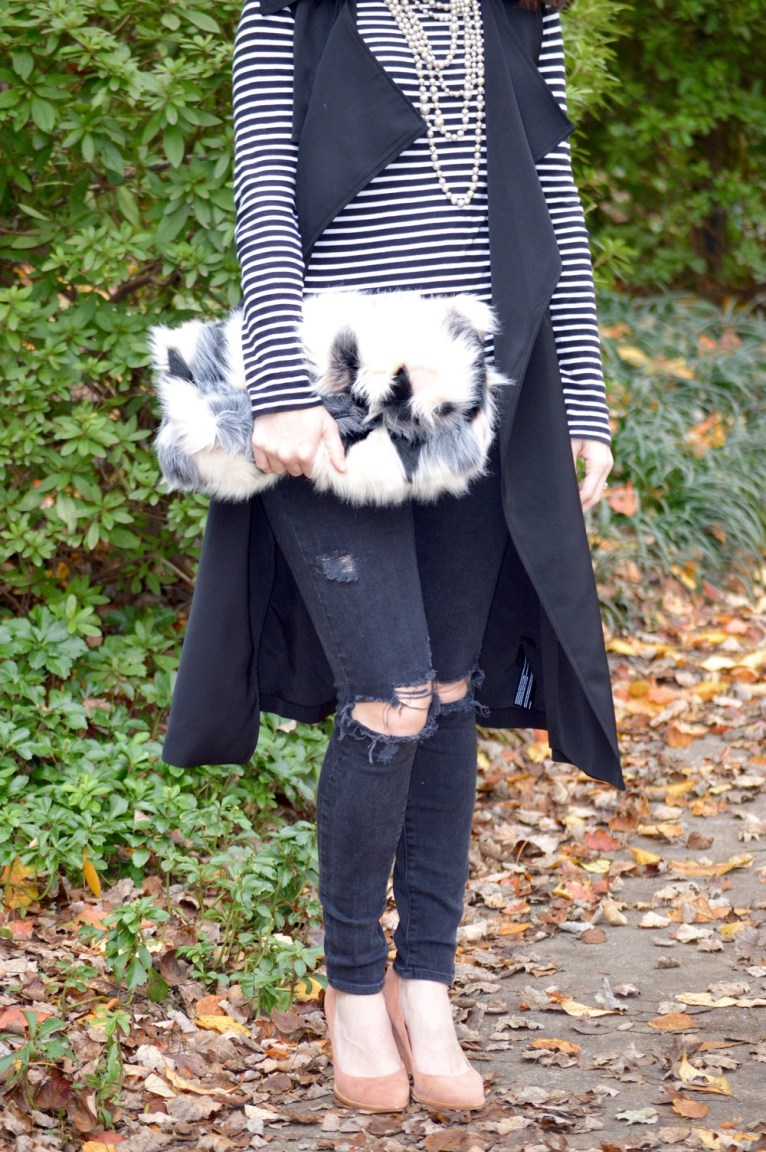 faux fur clutch and distressed jeans