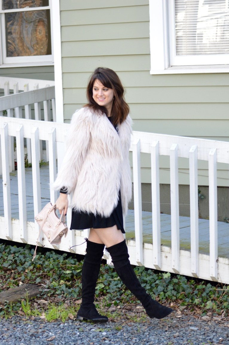 black swing dress and pink faux fur jacket